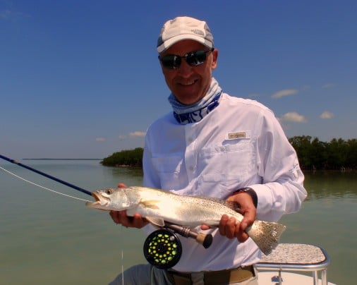 Alfredo With A Trout On Fly